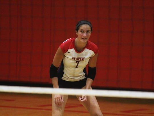 St. Henry junior Maria Tobergte gets ready for a point