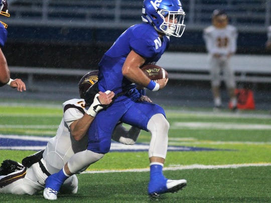 CovCath RB Casey McGinness tries to shed a tackler