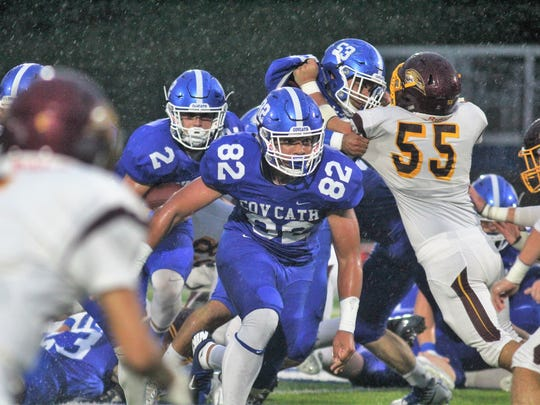 CovCath senior Kam Butler, 82, leads the way for Casey McGinness, 2, during Covington Catholic's 41-0 win over Cooper Sept. 1, 2017 at Covington Catholic HS, Park Hills.