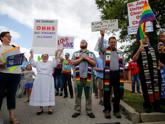 Counter-protesters show their support of the Gay Straight