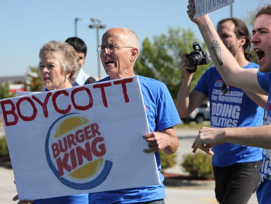 Protesters stand outside of the Ankeny Burger King