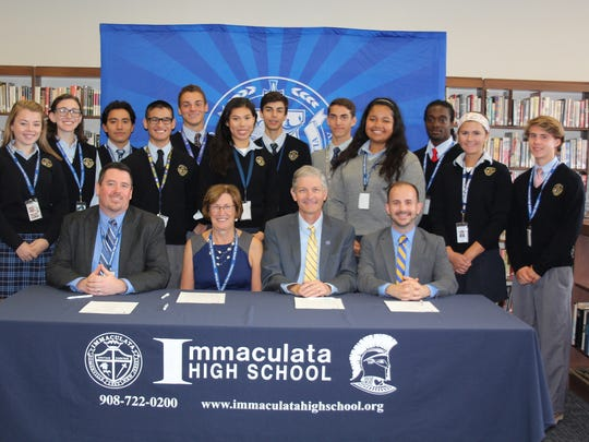 Immaculata student leaders attend the Georgian Court partnership ceremony with school administrators Immaculata Asst Principal for Academic Affairs, Immaculata Principal Jean Kline, Georgian Court President Dr. Joseph Marbach, and Georgian Court Dean of Admissions Justin G. Roy.