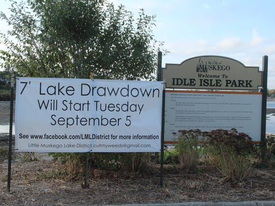 A sign at Idle Isle Park on Little Muskego Lake announced the drawdown.