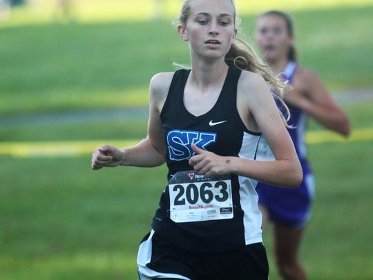 Simon Kenton junior Sophia DeLisio runs to the win