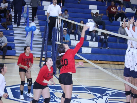 Cobre's Danielle Esqueda smashes this ball over during Saturday's volleyball match against Silver.