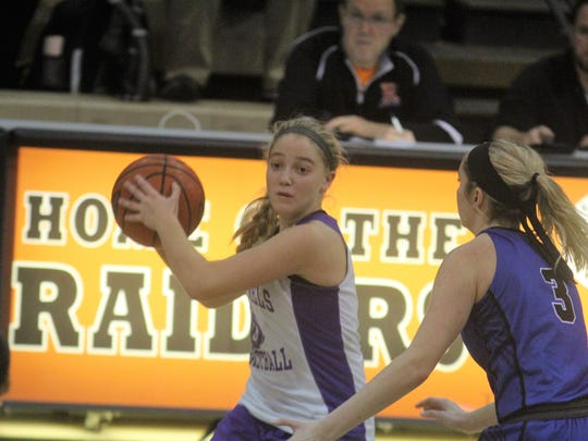 Campbell County senior Taylor Clos is guarded by Eastern