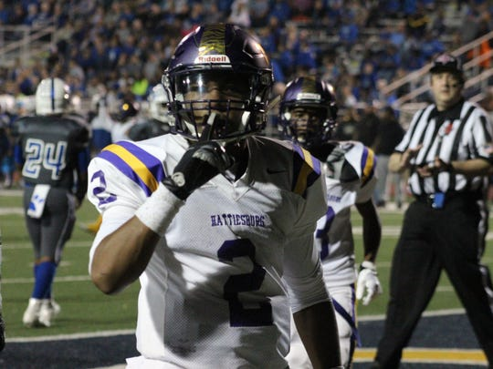 Hattiesburg quarterback Jarod Conner celebrates after scoring a touchdown against Stone in Friday's Class 5A South State semifinal game.