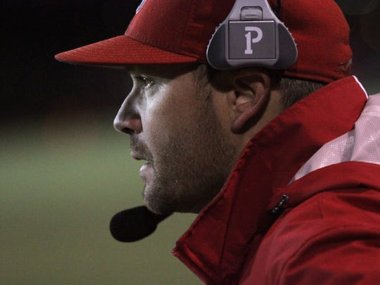 Shelby coach Erik Will watches his team from the sidelines while playing against Bellevue at Ashland High School on Friday night.