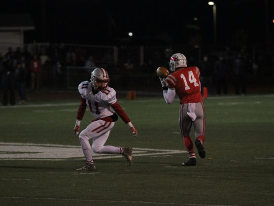 Bellevue's Treston Francis juggles a reception Friday from Riley Renwand against Shelby.