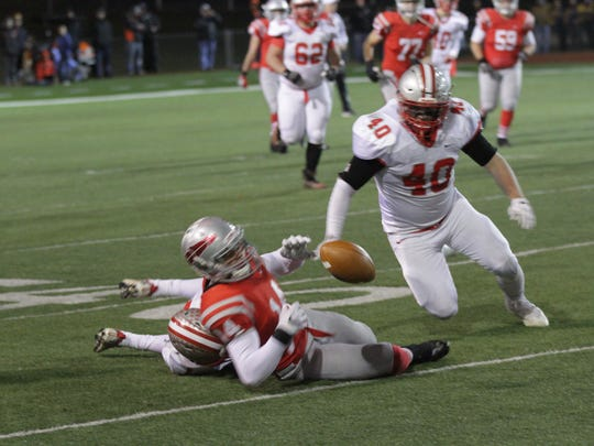 Shelby middle linebacker Hunter Bishop swoops in toward a loose ball during Friday's regional championship game against Bellevue. Bishop had a big pass deflection on fourth-and-goal from the 10 to help thwart a first half threat.