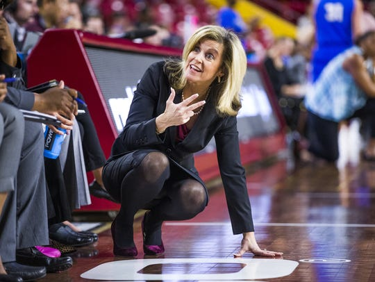 ASU head coach Charli Turner Thorne talks to her team