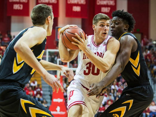 Indiana Hoosiers forward Collin Hartman (30) drives to the basket while Iowa Hawkeyes forward Tyler Cook (5) defends in the first half of the game at Assembly Hall.