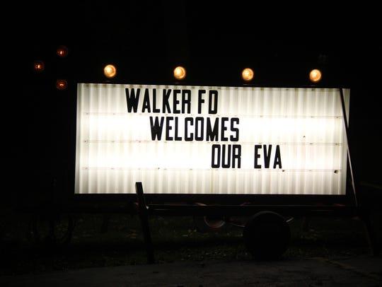 A large sign welcomed Eva Bruno, 6, of Brockport to