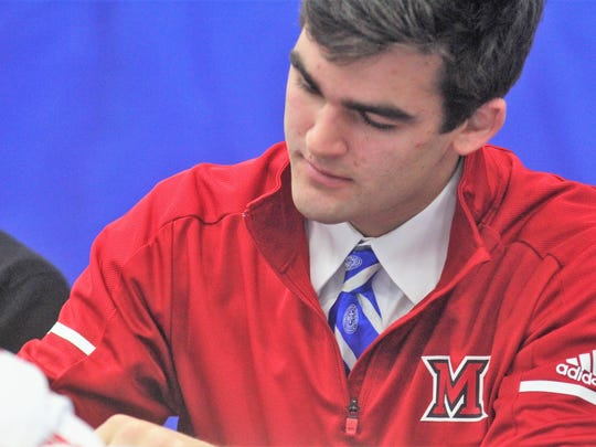 CovCath senior AJ Mayer during Covington Catholic's football signing ceremony for AJ Mayer and Kameron Butler Dec. 20, 2017 at the CovCath gymnasium, Park Hills KY. Both players signed with Miami of Ohio.