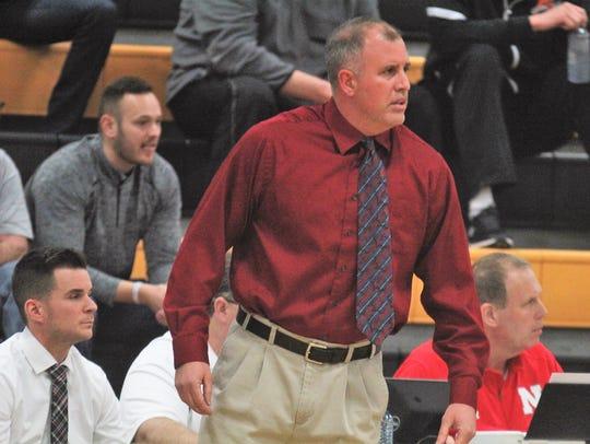 Newport head coach Rod Snapp shouts instructions during