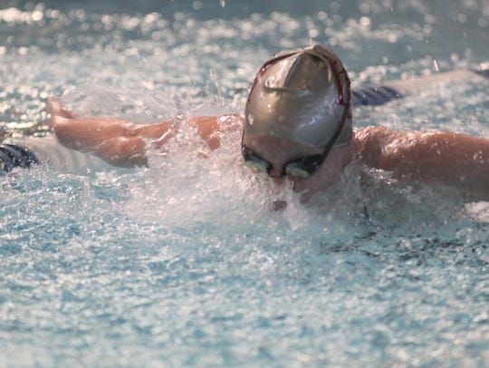 Dixie Heights senior Mallory Beil won the 100 butterfly