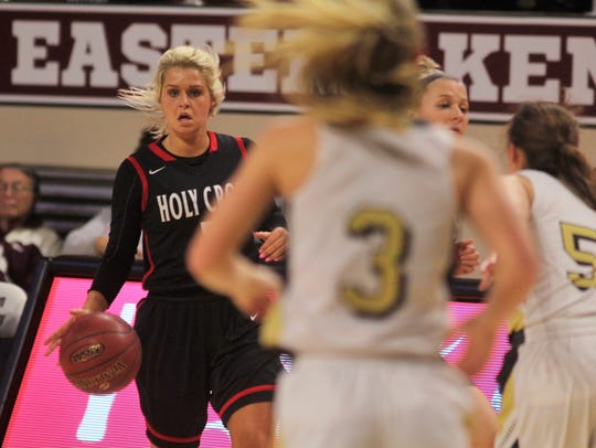 Holy Cross senior Bailee Harney looks for an opening