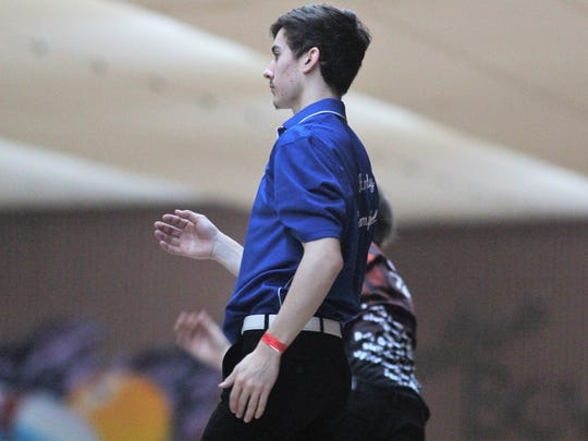 Highlands senior Andy Campbell watches his shot during
