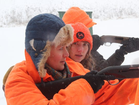 Maggie Chilsen (left), a novice hunter, receives shooting instruction from Emily Iehl, R3 and Shooting Sports Program Specialist at the Wisconsin Department of Natural Resources, during a Learn to Hunt for Food program at Hope Gun Club in McFarland, Wis.