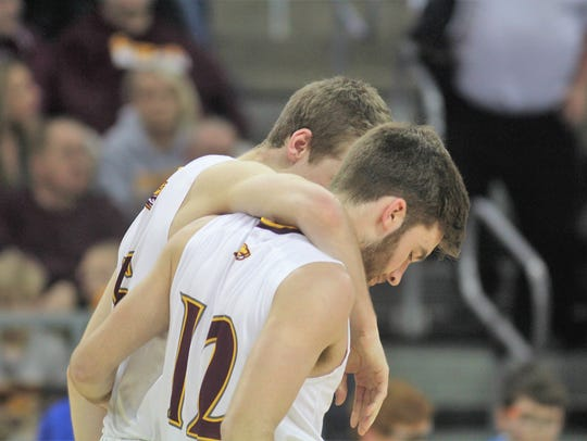 Cooper senior Adam Kunkel consoles Chris McNeil late