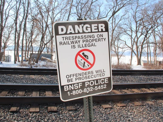 A sign placed along the railroad right-of-way near