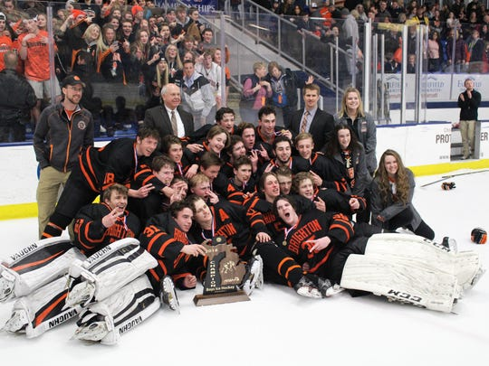 Brighton players pose with the Division 1 state trophy on Saturday, March 10, 2018.
