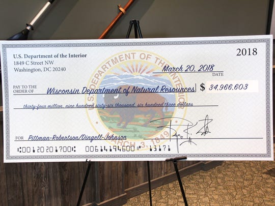 A commemorative check shows the nearly $35 million Wisconsin is eligible to receive under 2018 allocations from the Federal Wildlife and Sport Fish Restoration programs.