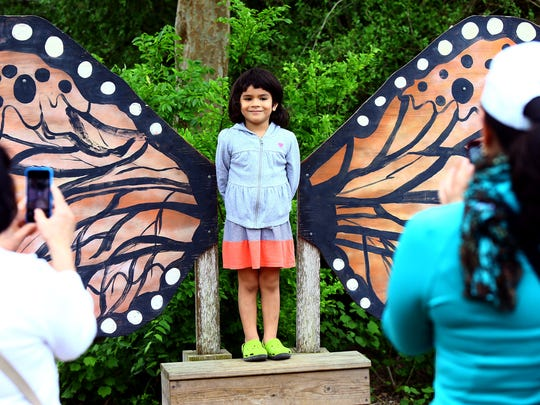 Renee Hinojosa, 4, smiles as she gets a photo taken bu her family during the Big Bloom event Saturday April 4, 2015 at the South Texas Botanical Gardens & Nature Center in Corpus Christi.