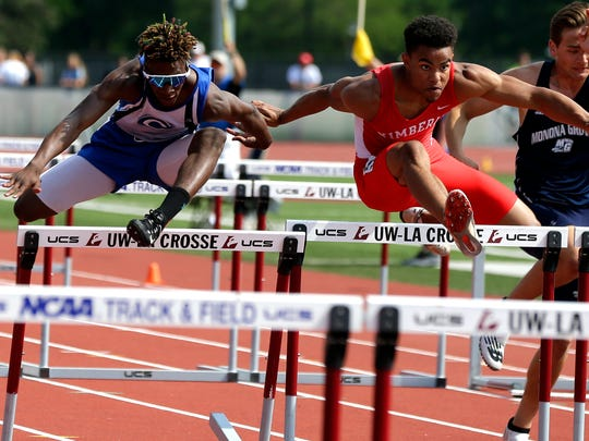 Kimberly's DJ Stewart, right, competes in the 110 meter