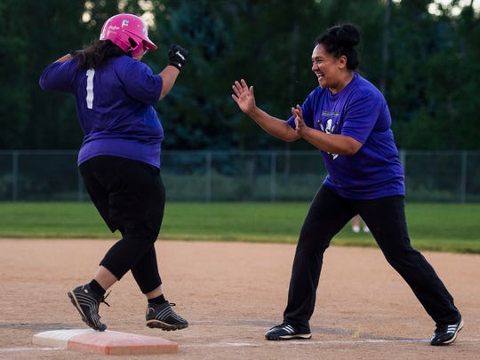 Kristi Ramos, left, celebrates with her mother Norma after connecting on a single during a Fort Collins Unified softball game against the Sliders on Monday, June 12, 2018, at Rolland Moore Park in Fort Collins, Colo.