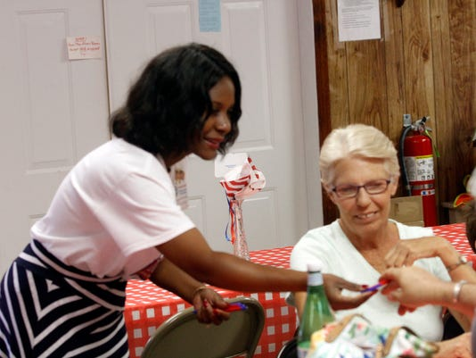 636653728708229543-Corinthia-Elder-campaigning-for-Montgomery-County-Trustee-at-Saturday-s-25th-Annual-Dotsonville-Community-Center-BBQ-12-.JPG
