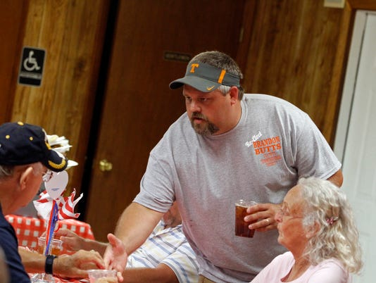 636653728709945554-Brandon-Butts-shaking-hands-in-his-reelection-bid-for-District-7-County-Commissioner-at-the-25th-Annual-Dotsonville-Community-Center-BBQ-10-.JPG