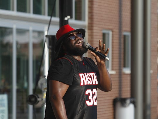 Gramps Morgan performs at Downtown Commons for Amazing Race Montgomery County on Friday.