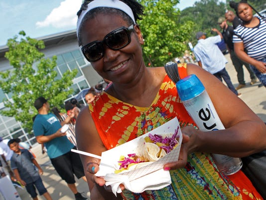 636666582529190263-Diane-Burnett-enjoying-some-Caribbean-tacos-at-Saturday-s-Riverfront-Jerk-Festival-63-.JPG