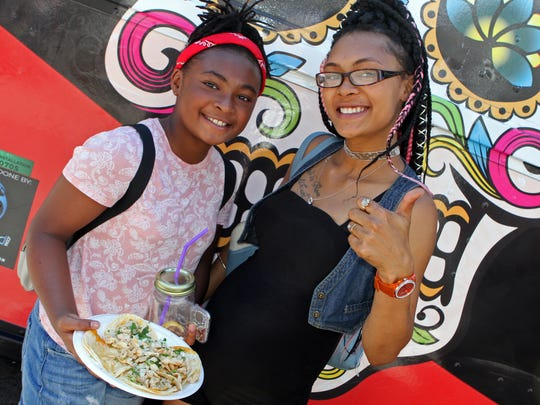 Jamyah and Myca McCullen having some tacos pollos from