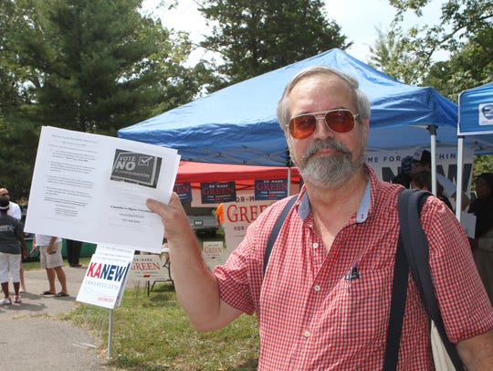 Steven Currie was garnering support against the November vote on consolidation at the 110th Lone Oak Picnic over the summer.