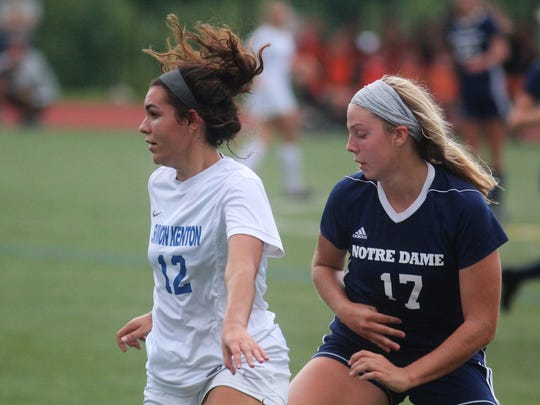 Simon Kenton senior Haley Dougherty, left, and Notre Dame junior Ellie Hellmann as Notre Dame beat Simon Kenton 3-2 in girls soccer August 20, 2018 at Notre Dame Academy, Park Hills KY. Both teams are in the top five of the state in various polls and are both defending regional champions.