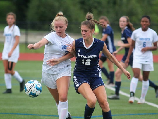 Simon Kenton sophomore Abigale Waddell, left, and Notre Dame senior Maya Decker battle for the ball as Notre Dame beat Simon Kenton 3-2 in girls soccer August 20, 2018 at Notre Dame Academy, Park Hills KY. Both teams are in the top five of the state in various polls and are both defending regional champions.