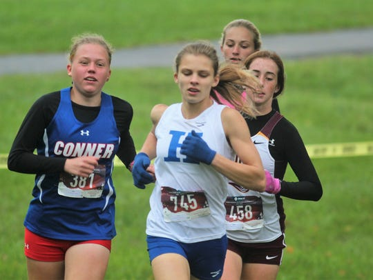 Leaders, from left, Conner freshman Ashlyn Vanlandingham, Highlands sophomore Maggie Schroeder, Cooper freshman Macey Ruth and Simon Kenton senior Sophia DeLisio (back), during the Northern Kentucky Athletic Conference cross country championships Oct. 13, 2018 at Idlewild Park in Burlington, KY.