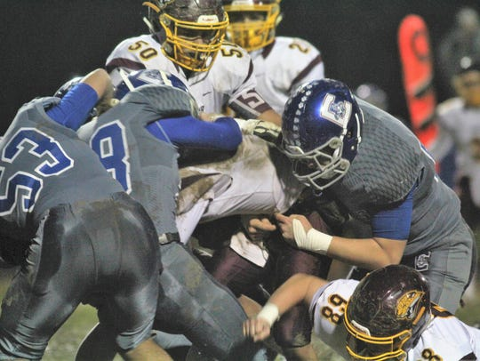 Conner Cougars converge on Cooper QB Jeremiah Lee during