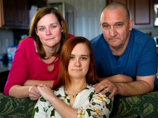 Caitlin Secrist, 21, and her parents Suzette and Bill