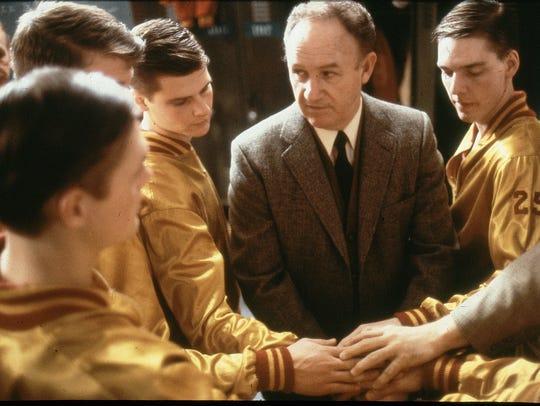 Actor Gene Hackman as Coach Norman Dale, prepares to