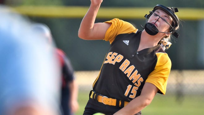 Southeast Polk's McKenzie Hilzer fires a pitch during the first inning against Marshalltown on Thursday.