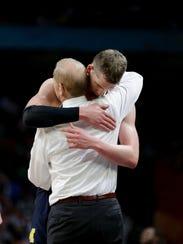 Michigan coach John Beilein hugs forward Moritz Wagner