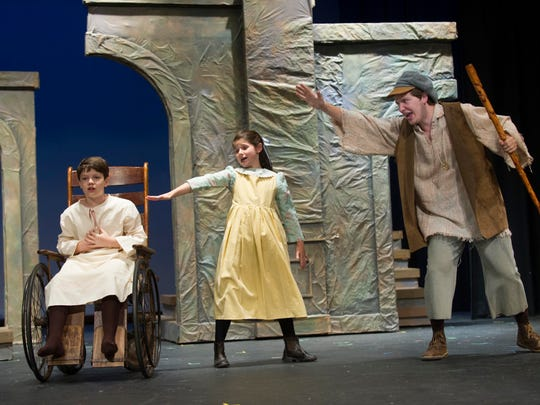 Josiah Mustaleski as Colin Craven, left, Maddie McKellar as Mary Lennox, and Taylor Kelly as Dickon perform during a rehearsal of 'The Secret Garden' Wednesday, July 2, 2014, at Bearden High School. The WordPlayers are presenting the classic children's story at the Bijou Theatre July 18 - 20. (PAUL EFIRD/NEWS SENTINEL)