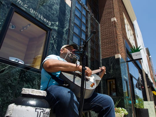 Kevin Burt, of Coralville, performs in front of M.C.