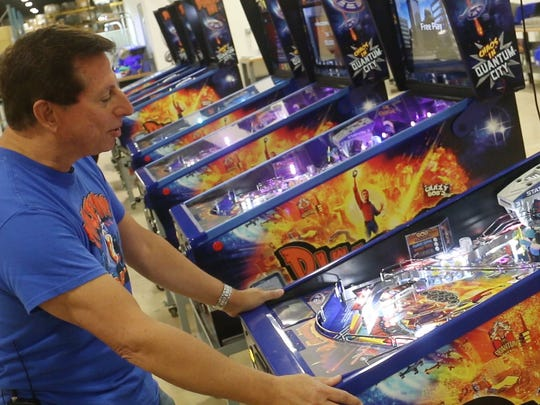 """Jack Guarnieri, owner of Jersey Jack Pinball in Lakewood, plays the company's """"Dialed In"""" game."""