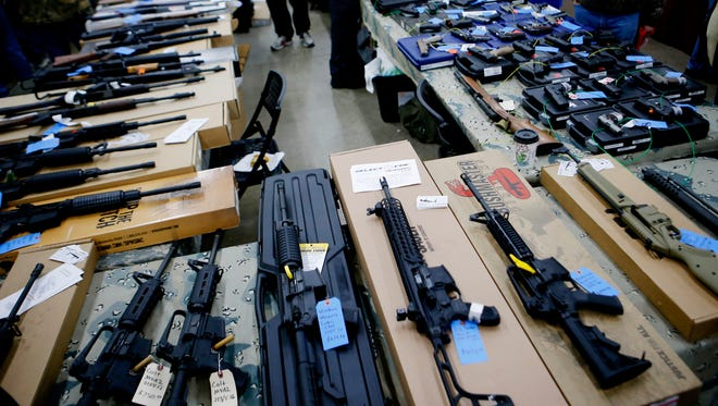 Firearms are seen for sale at the Waukesha Expo Forum Gun Show in 2016. Police reported break-ins at gun shops in Oconomowoc and Waukesha early Jan. 19.