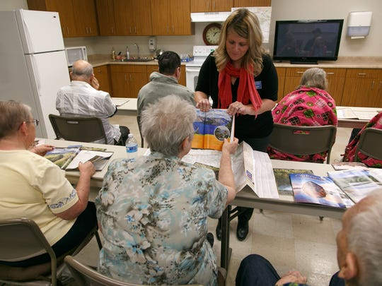 Alzheimer's and Dementia Society Respite Manager Tiffany Raban  shows pictures of Oregon to a class at the St. George Senior Center Tuesday, Oct. 7, 2014.
