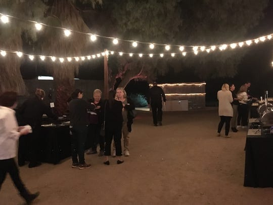 Guests mingled in the outdoor event space at the Desert Adventures Red Jeep Tours & Events venue in the Indio Hills. The sapce accommodates everything from corporate meetings to birthday parties.